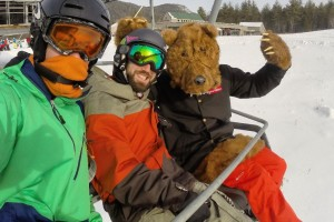 attitash snowboarding bear suit gnarbear skiing rail backyard